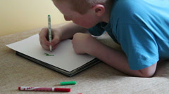 Boy draws felt pen Stock Footage