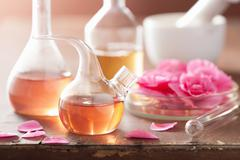 Aromatherapy and alchemy with pink flowers Stock Photos