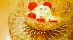 Eating vanilla ice cream ball with jelly. Macro fast speed video Stock Footage