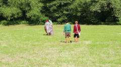 Germanic warrior are going away, these clip was shot at a war reenactment Stock Footage