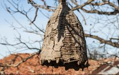 Old beehive for wild bees - stock photo
