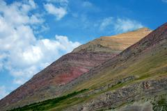 Multi-colored Mountain with White Clouds Stock Photos