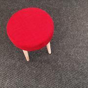 Red stool on gray carpet floor - stock photo