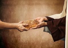 Jesus gives the bread to a beggar. - stock photo