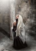 Jesus kneel in prayer - stock photo