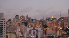 View of the city at sunset. Sao Paulo, Brazil. Day to night.  4k (4096 X 2304) Stock Footage