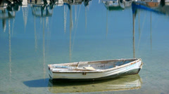 Row Boat in Harbor - stock footage