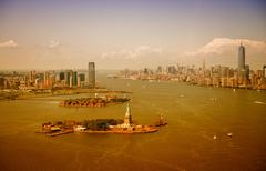 The Statue of Liberty, Manhattan and Jersey City skyline, aerial Stock Photos