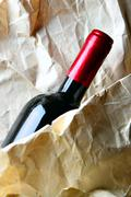 Red wine and crumpled paper-bag Stock Photos