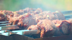 Meat being roasted on a grill Stock Footage