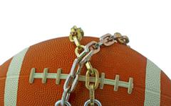 Football in chains - stock photo
