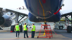 Passangers leaving the aircraft upon arrival - stock footage
