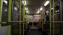 BUDAPEST OLD METRO TRAIN INSIDE ARRIVING STATION DOOR OPENS Stock Footage