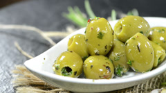 Bowl with pickled green olives (loopable) Stock Footage