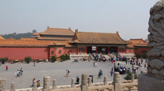 Tourists viewing the forbidden city in courtyard in beijing china Stock Footage