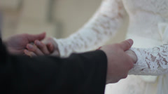 Groom holds the bride's hands Stock Footage