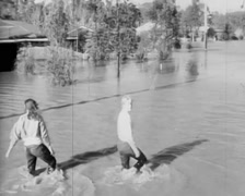 People Walking Through Floodwaters, Shepparton Floods, Early 70s (2) Stock Footage