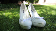 White wedding bridal shoes on grass Stock Footage