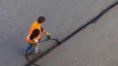 Construction worker applying new hot Asphalte on road surface Stock Footage