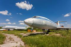 old russian aircraft tu-154 at an abandoned aerodrome - stock photo