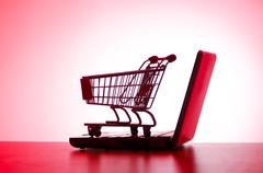 Stock Photo of Silhoette of laptop and shopping cart