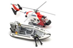 Helicopter and motor boat Stock Photos