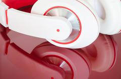 White red headphones on vinous surface Stock Photos