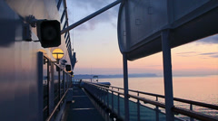 Dawn lights the empty deck of a cruise ship-HD3099 Stock Footage