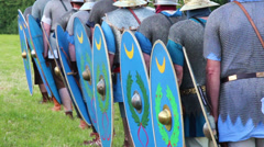 Small group of roman soldiers are attacking enemies at a roman war reenactment s Stock Footage