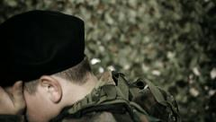 Sorrowful soldier lowering his head Stock Footage