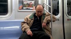 Man is sleeps in the subway car. NYC, New York, USA. Stock Footage