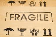 Stock Photo of fragile sign on wood