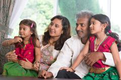 Indian family looking to side Stock Photos