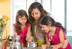 indian family cooking - stock photo
