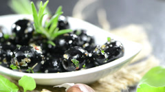 Portion of black olives (not loopable) Stock Footage