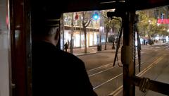 Stock Video Footage of Market street  through the streetcar driver's cab at night. San Francisco
