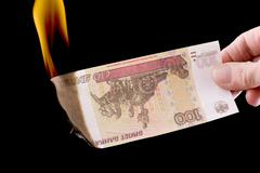 burning paper currency macro - stock photo