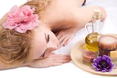 Woman lying with spa products Stock Photos