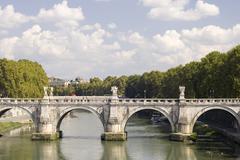 Rome river Tiber with bridge - stock photo