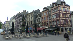 General view of old buildings along Rue de la Pie in central Rouen, France. Stock Footage