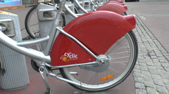 Cy'clic bikes for hire parked in a bike station in Rouen, France. Stock Footage