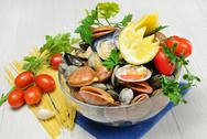 Stock Photo of raw seafood called fasolari with mussels and clams