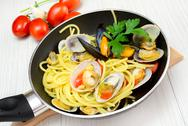 Stock Photo of spaghetti with clams fasolari and mussels