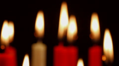 Burning Candles Out Of Focus To Focus Stock Footage
