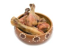 Stock Photo of chicken leg in dish close up