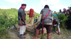 Roman soldiers attack with stones, these clip was shot at a war reenactment Stock Footage