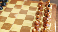 Old chess pieces on a chessboard Stock Footage
