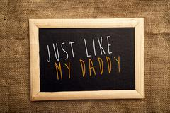 Just like my daddy - stock photo