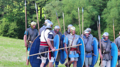 Small group of roman soldiers are attacking enemies  Stock Footage