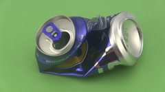 Crushed drinks can on a green background. Stock Footage